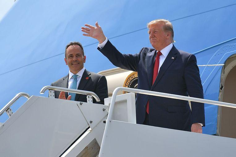 President Trump (rechts) voert - tevergeefs, zo blijkt nu - campagne voor gouverneur Bevin. Beeld AFP