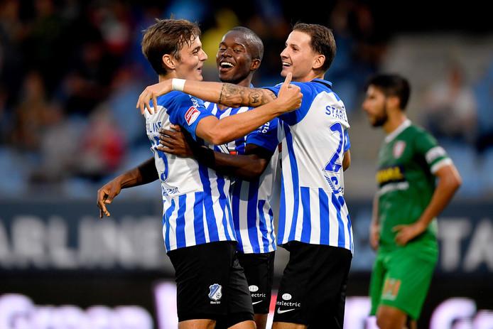 Kaj de Rooij (l), Marcelo Lopes en Joey Sleegers (r) vieren een doelpunt van FC Eindhoven tegen FC Dordrecht (5-1 winst).