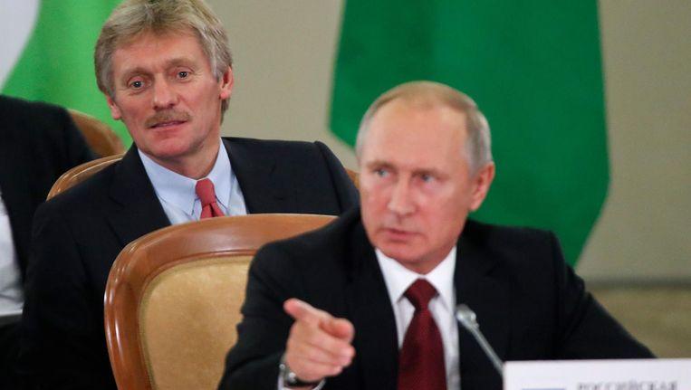 Dmitri Peskov en Vladimir Poetin Beeld anp