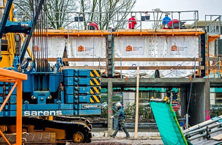 De bouw kampt sinds de kaalslag in de crisis nog altijd met een tekort aan personeel. Beeld Hollandse Hoogte / Frank de Roo