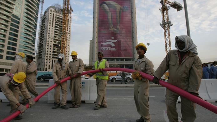 Immigranten die in de constructie werken in Doha, de hoofdstad van Qatar.