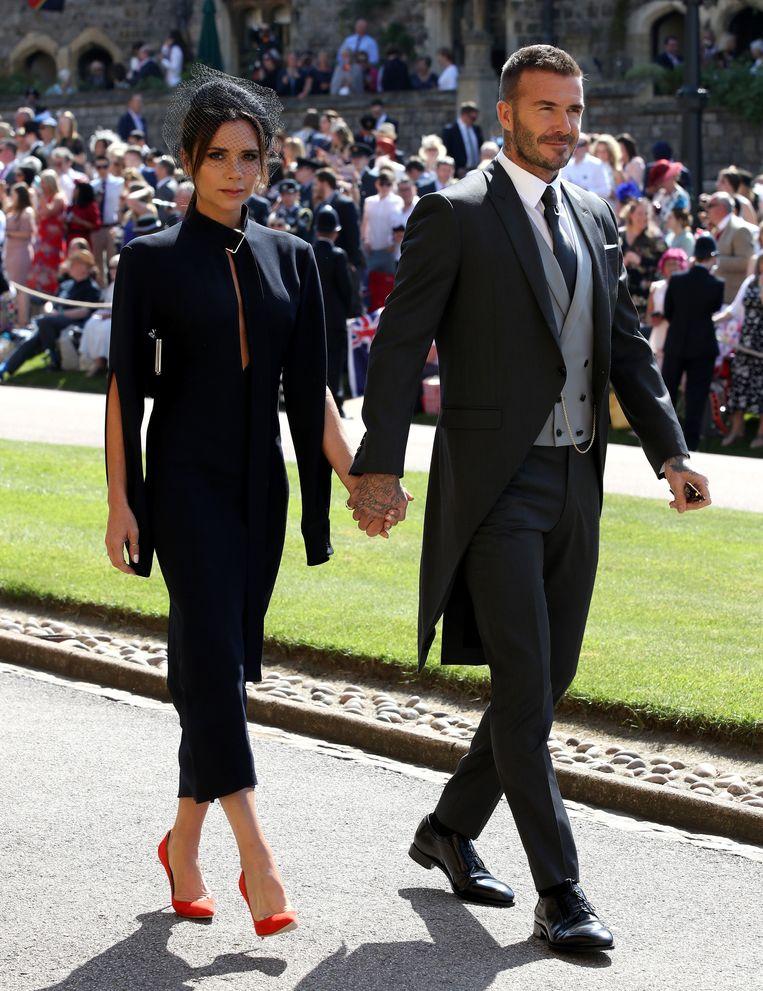 Victoria en David Beckham bij de bruiloft van prins Harry en Meghan Markle in 2018.  Beeld Getty Images