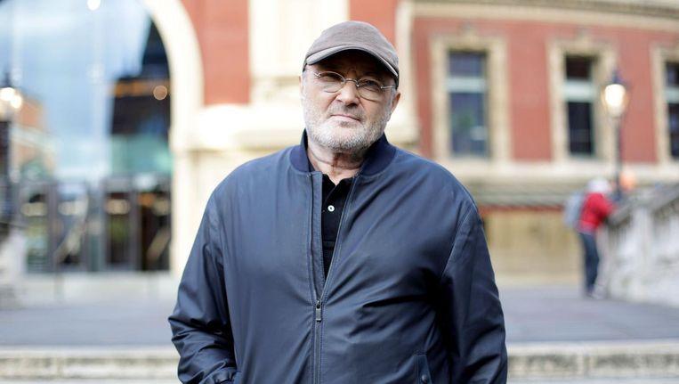 Phil Collins voor de Royal Albert Hall in Londen. Beeld photo_news