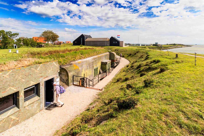 De zeventien bunkers van Kornwerderzand op de Afsluitdijk vormen nu het Kazemattenmuseum. Beeld Sander Groen