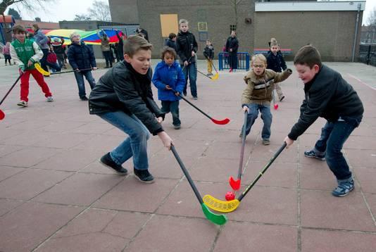 Kinderen spelen op het schoolplein van De Zevenster