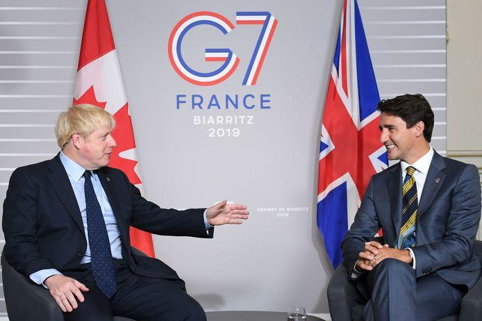 De Britse premier Boris Johnson en de Canadese premier Justin Trudeau  tijdens de G7-top in augustus vorig jaar in Frankrijk.