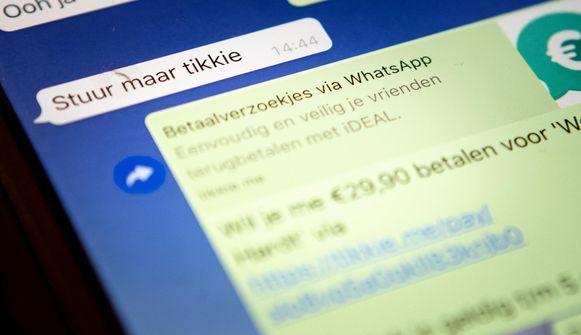 Foto ter illustratie: de Tikkie-app, een in Nederland populaire app waarmee je met vrienden of familie onderling kleine bedragen kunt overmaken.