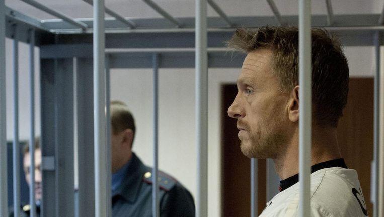 De Nederlandse activist Mannes Ubels in de rechtbank in Moermansk. Beeld EPA