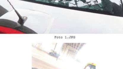 Stuk beton van brokkelbrug dwars door achterruit voorbijrijdende auto