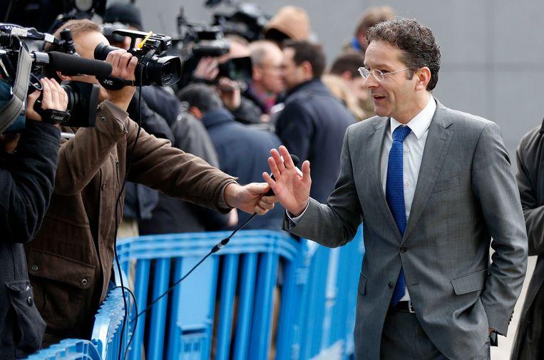Dijsselbloem spreekt met de pers in Brussel. Beeld REUTERS