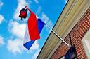 De vlag hangt uit bij een geslaagde in Tilburg