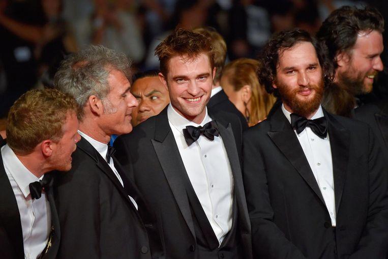 Robert Pattinson, midden, zou lijden aan een posttraumatisch stresssyndroom sinds hij de hoofdrol vertolkte in Twilight. Beeld anp