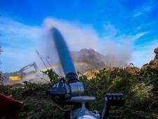 Grote brand in stapel maaisel in Aarle-Rixtel, de rest van de dag nog stankoverlast