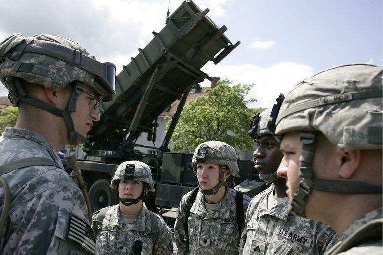 Amerikaanse militairen bij een Patriot-installatie in Morag in Polen. © epa Beeld