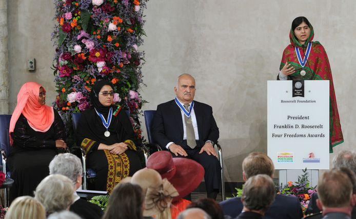Malala ontving in 2014 de Four Freedoms Award in de Nieuwe Kerk in Middelburg. Daarbij waren ook koning Willem-Alexander (voorste rij, tweede van rechts) en koningin Máxima (oranje hoed) aanwezig.