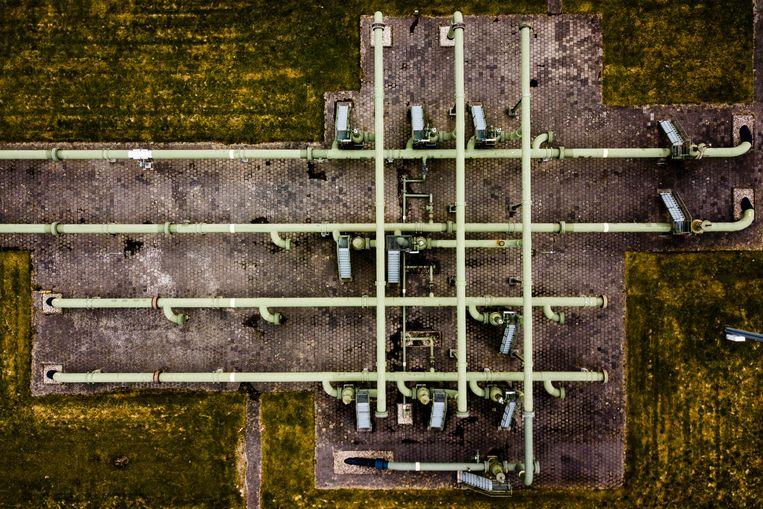 Een gaswinningslocatie van de NAM in Muntendam, gezien vanuit de lucht. Beeld ANP