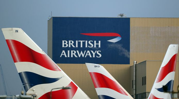 FILE PHOTO: British Airways logos on aircraft tail fins at Heathrow Airport in west London, Britain, February 23, 2018. REUTERS/Hannah McKay/File Photo