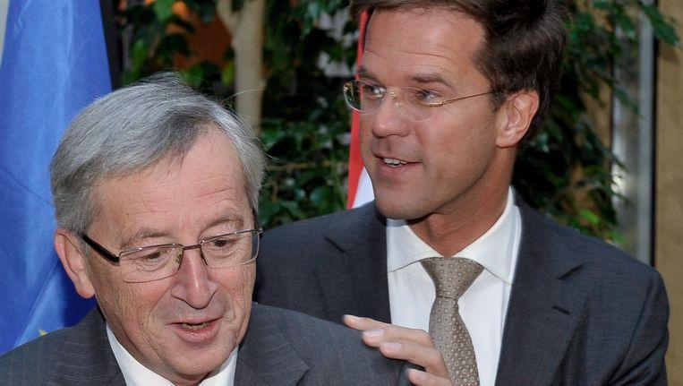 Rutte en Juncker tijdens een gezamenlijke persconferentie in 2010. Beeld EPA