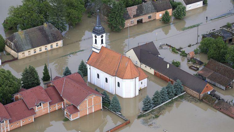 Luchtfoto van Gunja, een dorpje in het oosten van Kroatië, afgelopen zondag. Beeld ap