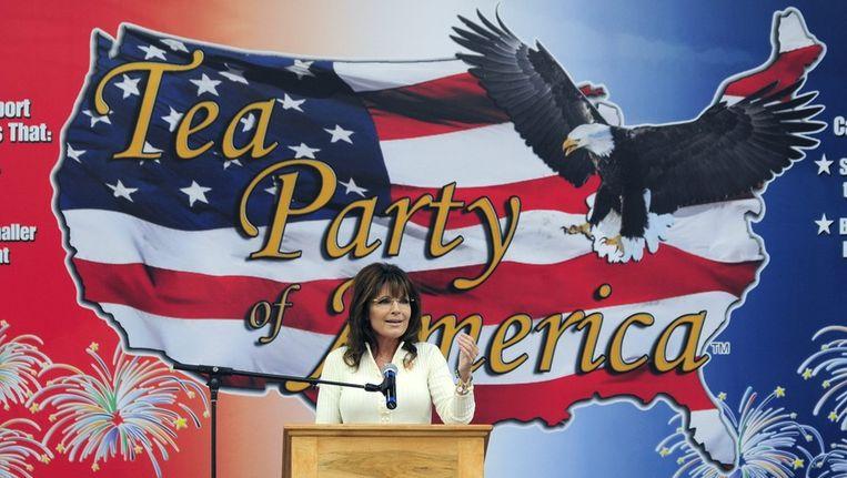 Sarah Palin spreekt op een bijeenkomst in Iowa de Tea Party-aanhang toe. Beeld bruno