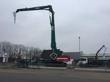 Enorme machine voor Rijssense Gebouwen Sloperij