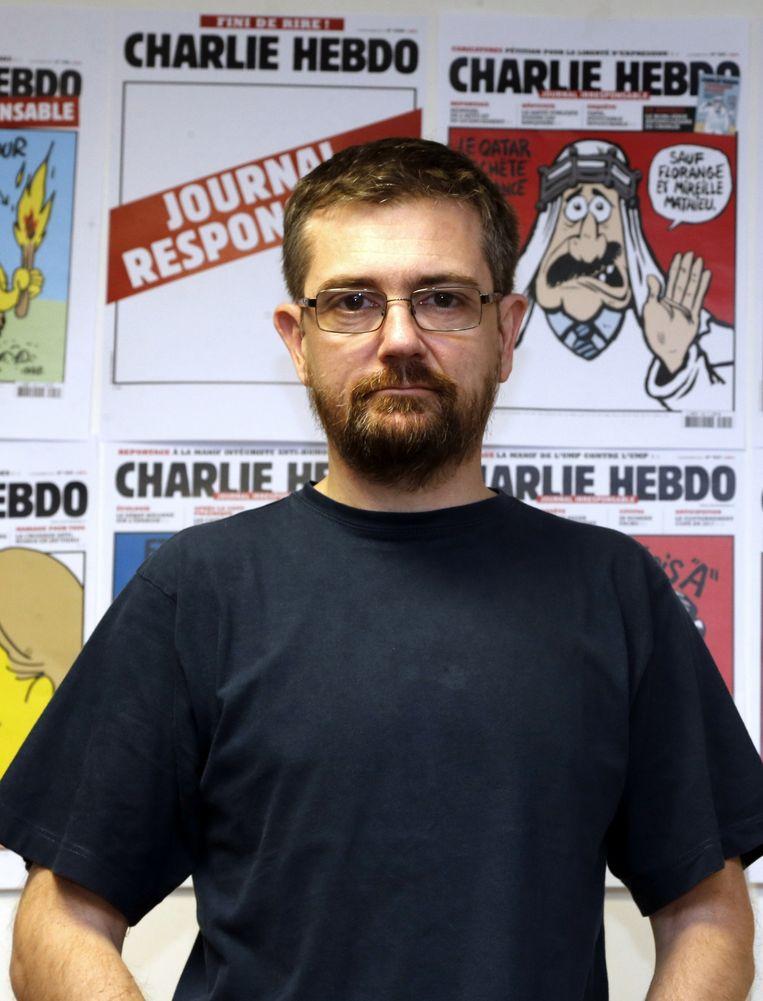 Cartoonist en voormalig hoofdredacteur Charb op een foto van december 2012. Beeld afp