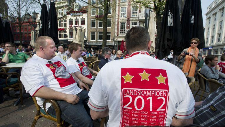 Aan het eind van de middag was het op het Leidseplein al druk met fans van Ajax. Beeld anp