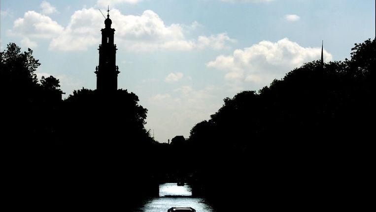 Het stadsdeel staakt het 'live' bespelen van de carillons van de Westerkerk, de Oude Kerk, de Zuiderkerk en de Munt. Foto ANP Beeld