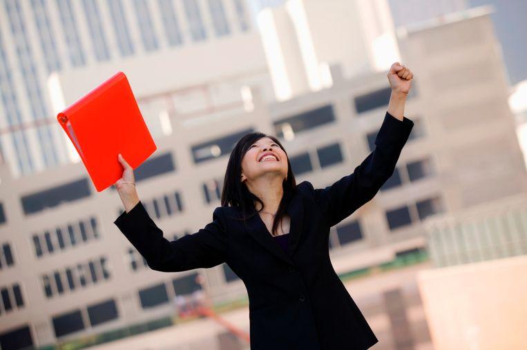 Celebrating businesswoman with folder