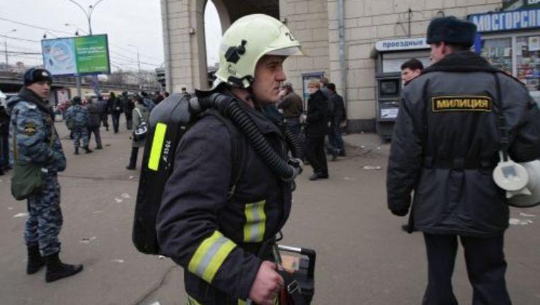 Hulpdiensten spoeden zich naar de plek van de aanslag. ANP Beeld