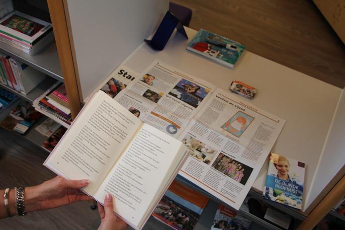 In de Taalhuis-hoek staan onder andere iets minder dikke boeken met meer wit tussen de stukken tekst, voor wie wat langzamer leest.