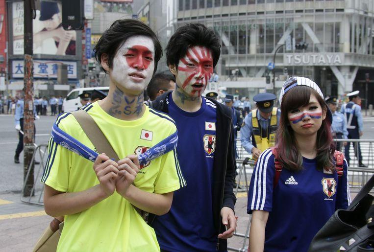 Teleurgestelde fans na de uitschakeling van Japan. Beeld epa