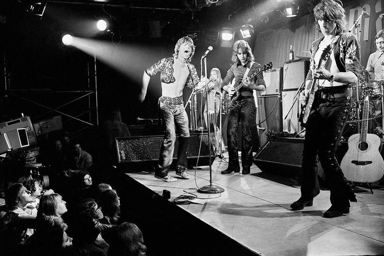 The Stones live in de Londense Marquee-club, maart 1971. Links Mick Jagger, Mick Taylor, Keith Richards en Charlie Watts. De trompettist achterin is Jim Price. Beeld AP/Press Association Images