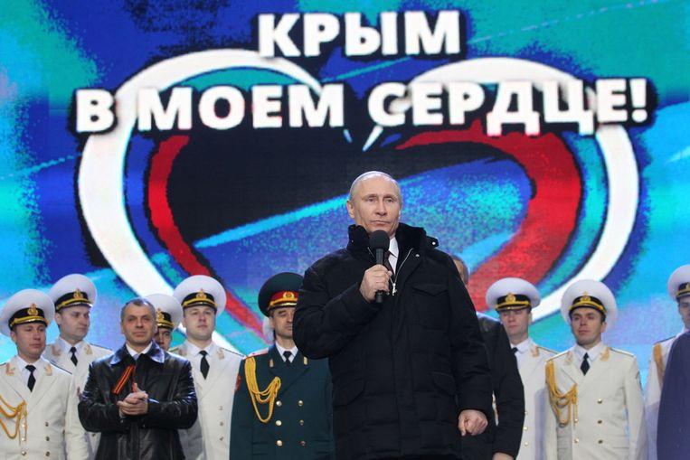 President Poetin op het Rode plein in Moskou. Beeld getty