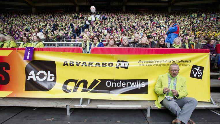 - Leraren en leraressen uit het basisonderwijs zijn verzameld in de Amsterdamse Arena voor het protest van de onderwijsbonden vorig jaar Beeld ANP