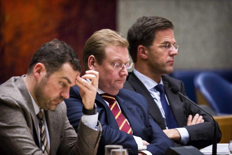 De bewindslieden op een rij in vak K: Dijkhoff, Van der Steur en Rutte. Beeld anp