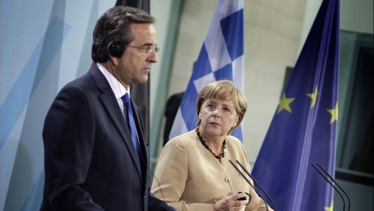 De Griekse premier Antonis Samaras op bezoek bij de Duitse bondskanselier Angela Merkel.