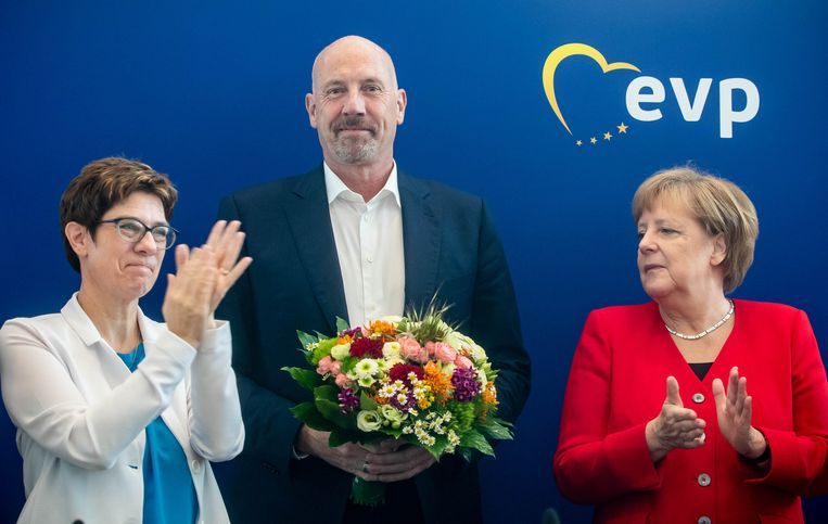Annegret Kramp-Karrenbauer, Carsten Meyer-Heder en Angela Merkel op een partijbijeenkomst gisteren.