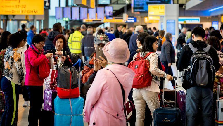 Drukte op de luchthaven Schiphol. Beeld anp