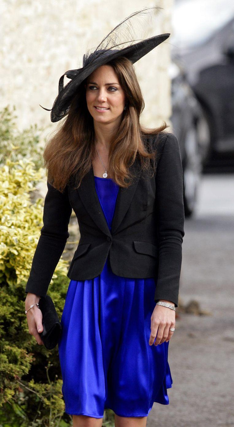 Kate met de zwarte hoed op het huwelijk van Harry Meade