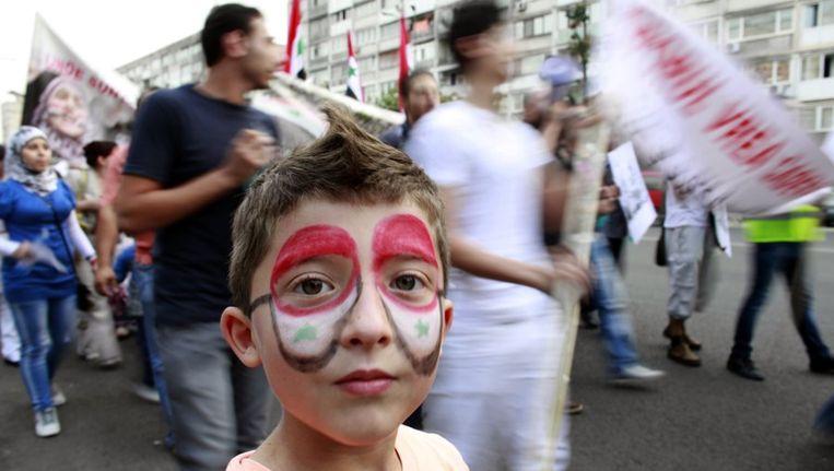 Demonstratie van de Syrische minderheid in de Roemeense hoofdstad Boekarest. Beeld reuters