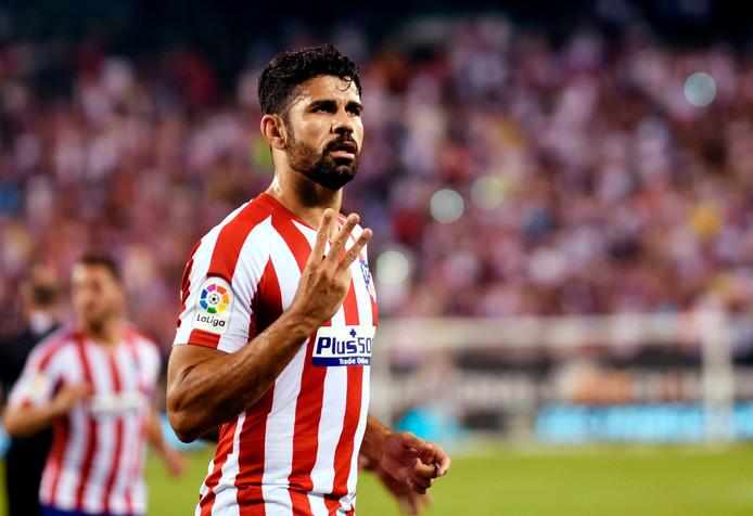 Diego Costa van Atletico Madrid viert zijn derde treffer.