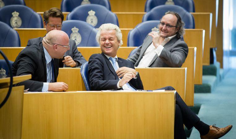 Hilariteit in de bankjes van de PVV-fractie. Linksachter Kamerlid Martin Bosma. Beeld ANP