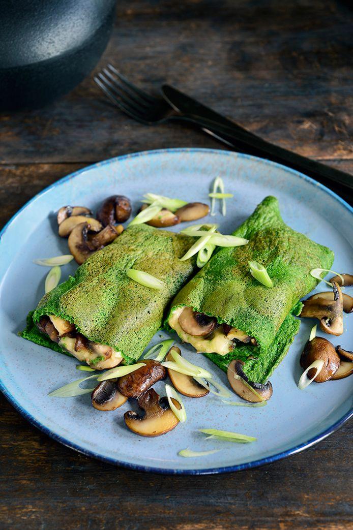 Opgerolde spinazieomelet met champignons en kaas