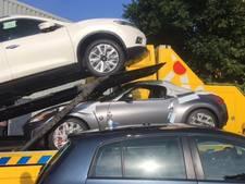 Politie stuit op loods vol gestolen splinternieuwe auto's