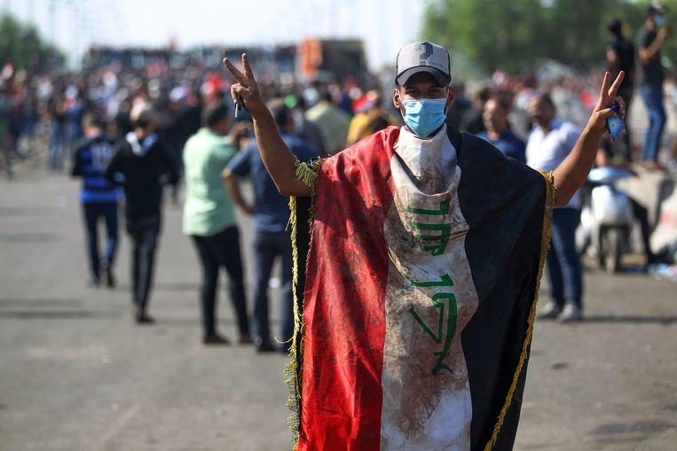 Een Iraakse betoger in Bagdad op 26 oktober 2019.