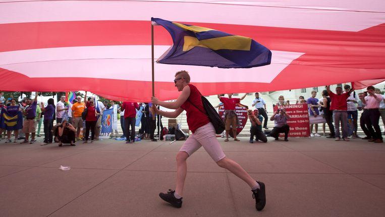 Een demonstrant voor het homohuwelijk in Washington DC. Beeld epa