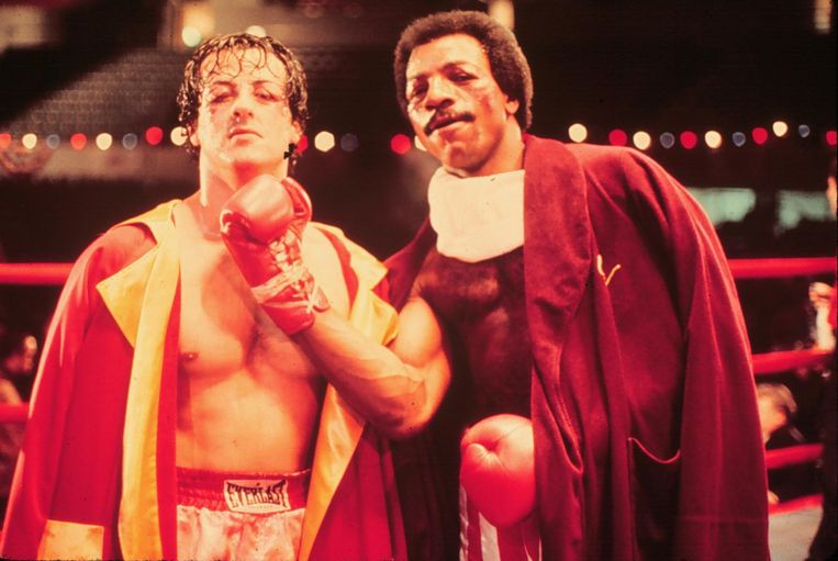 Sylvester Stallone en Carl Weathers in Rocky Beeld anp