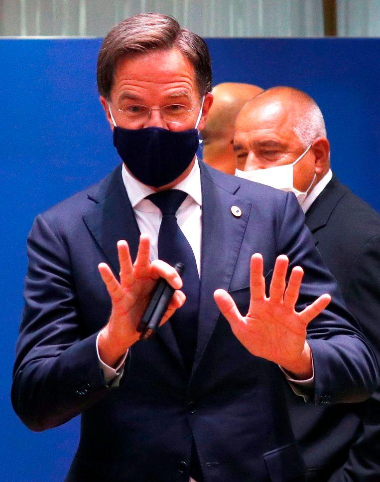 Premier Mark Rutte is erg ontspannen, dit weekend in Brussel. Beeld AFP