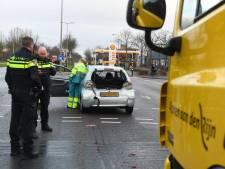 Vrouw gewond na aanrijding met vuilniswagen